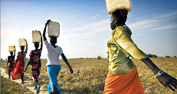 women carry water-200 million hours per day collecting water
